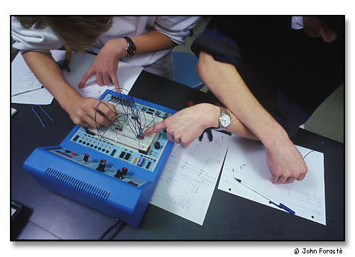 Students working together on electronic circuit. <br>During Math/Science Day for visiting high school students. <br>Wheaton College, Norton, Massachusetts. November 1999.