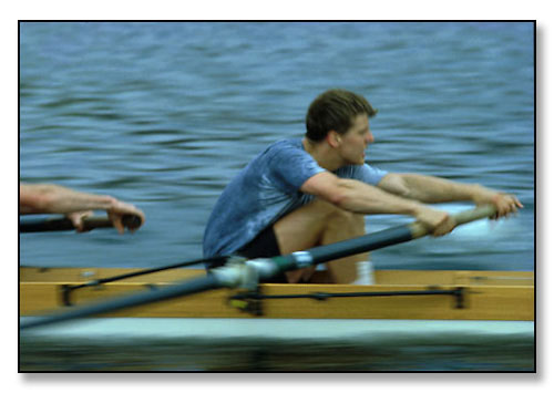 Brown University rower at full pace and top of stroke during crew practice. <br>Seekonk River, Providence, Rhode Island. April 1984.