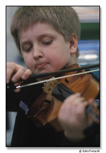 >James Marcil, a Community MusicWorks' student during violin lesson. <br>The West End Community Center, Providence, Rhode Island. April 2002.