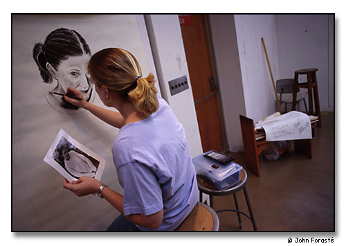Student drawing self-portrait during art class. <br>Wheaton College, Norton, Massachusetts. April 1999.