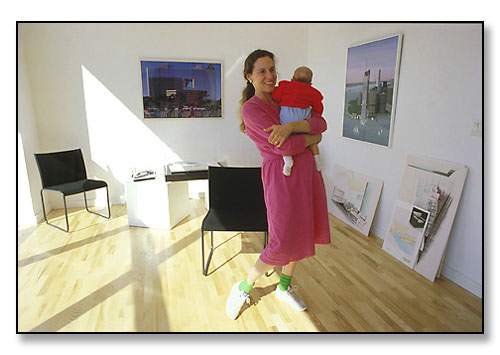 Laurinda Spear with her baby in her architectural studio. <br>Co-founder of the very successful firm, Arquitectonica, in Miami, Florida.<br>Photograph made for feature story in the Brown Alumni Magazine. February 1987.