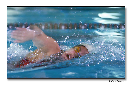 Katie Cowan, outstanding collegiate swimmer, training for Nationals. <br>The Smith Swim Center, Brown University, Providence, Rhode Island. March 1997.