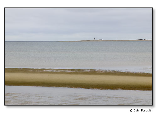 Tidal flat and lighthouse. Cape Cod. April 2006.