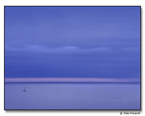 Water, sky and sailboat at dusk, off Acadia National Park, Maine. September 2001.
