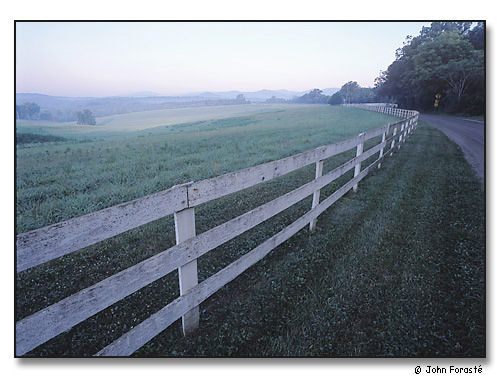 Fence and field, Greene County, Virginia. In the distance, the Blue Ridge Mountains of Shenandoah National Park.