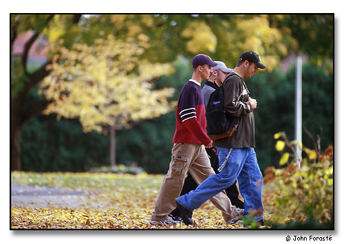 Three students between class on beautiful fall day. <br>Wheaton College, Norton, Massachusetts. November 1999.
