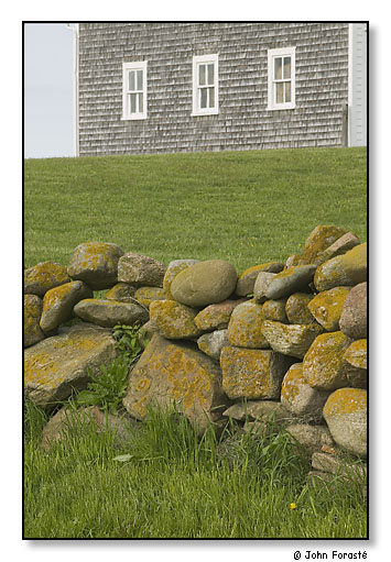 Stone wall and the Mitchell Farm barn. Corn Neck Road, Block Island, Rhode Island. May 2004.