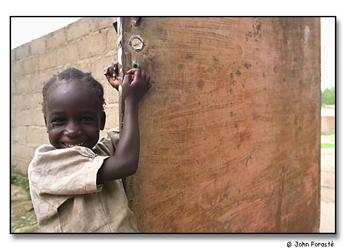 Fatti's smile. <br>Mora, Cameroon, (central west) Africa. August 2002.