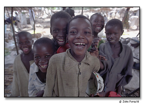 Laughing boys in market, Mora, Cameroon, Africa