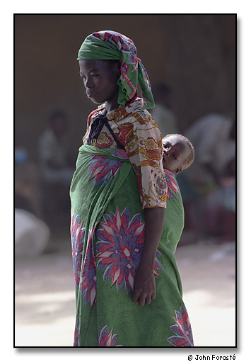 Woman and baby in market, Mora, Cameroon, Africa