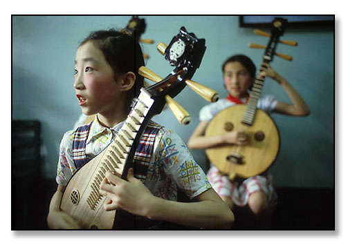 Girls playing traditional chinese instruments. China. July 1979.